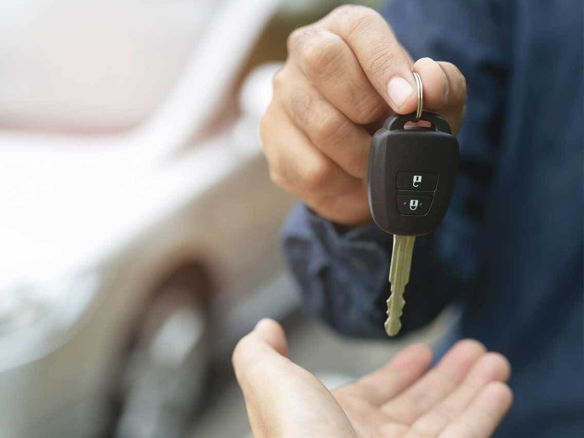 Car keys being handed to new owner