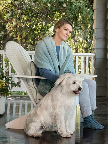 Woman sitting on porch with dog