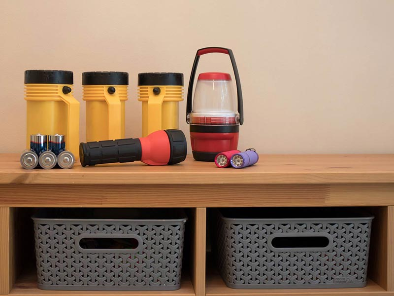 Flashlights, batteries, and other items for a household safety kit