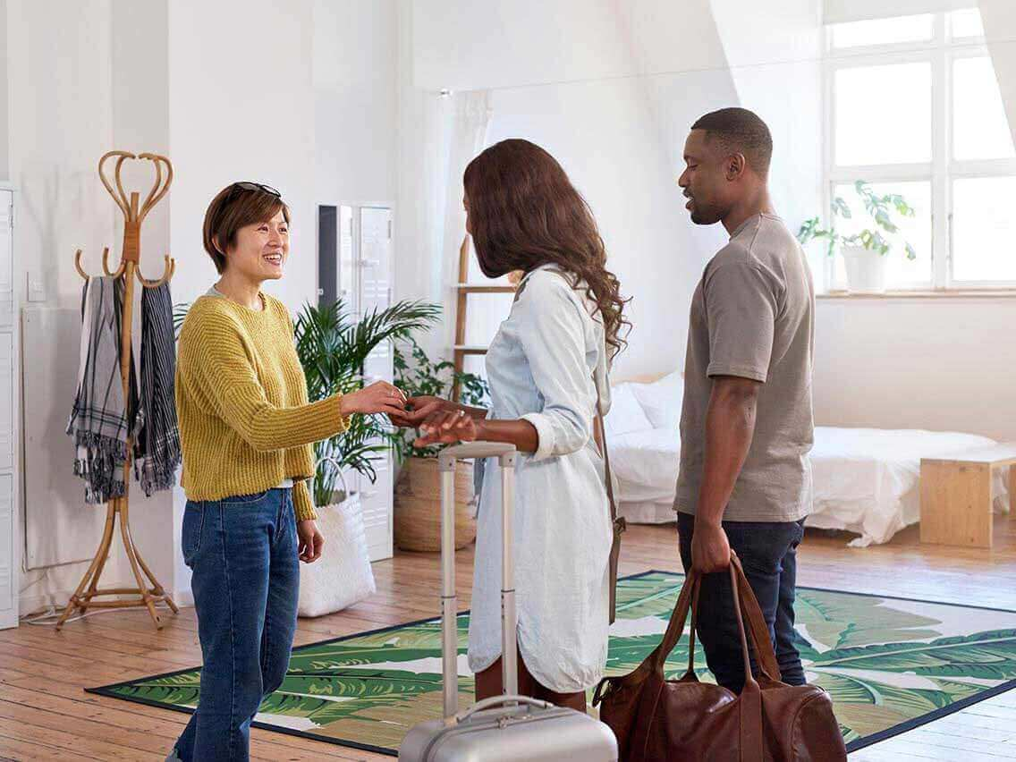 Couple greeting their homeshare host