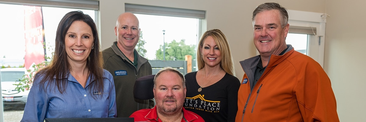 people inside home built for an ALS patient