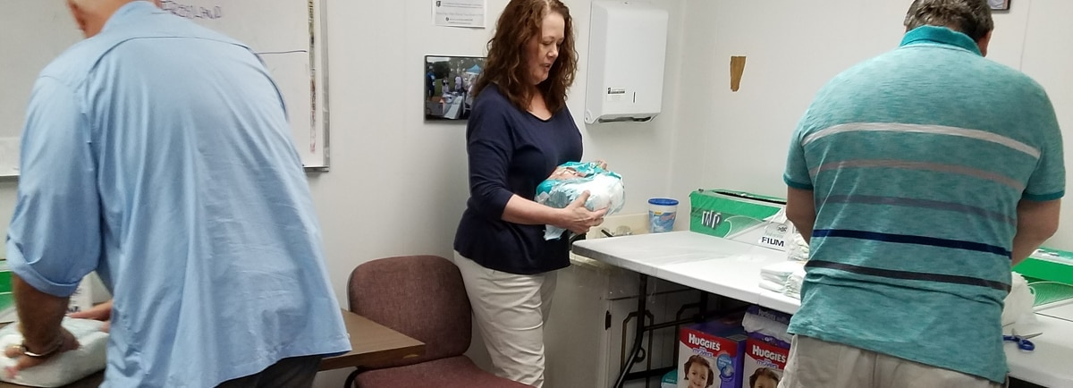 agents wrapping diapers for distribution