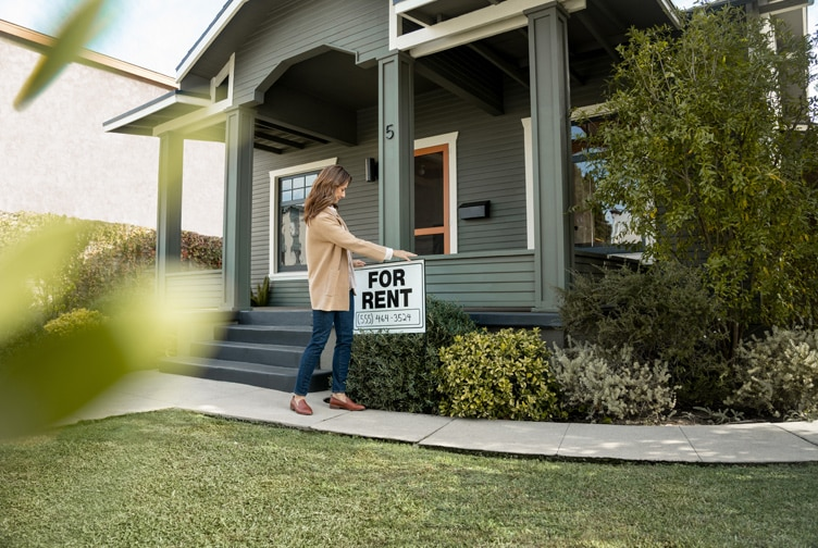 "Woman places ""For Rent"" sign on her front lawn."